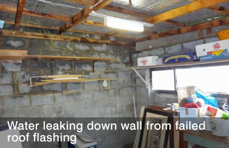 Water leaking down wall from failed roof flashing